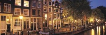m-c_amsterdam_melkmeisjesbrug_nacht_560x350_tcm483-135943