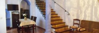 El salón del dúplex de 150 metros con acceso a terraza de 80